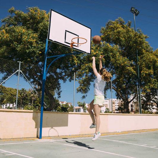young-woman-making-basketball-jump-shot